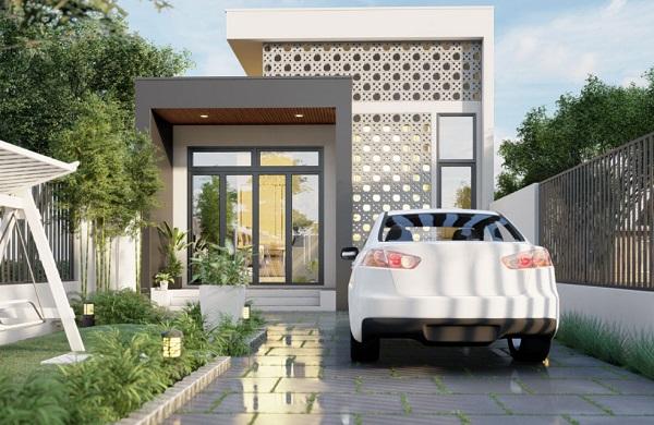 Mẫu nhà nhỏ này được thiết kế đơn giản, tinh tế với gam màu trắng là màu chủ đạo. Điểm nhấn nổi bật cho căn nhà này là những ô gạch bông gió xinh xắn và khoảng sân vườn phía trước giúp tô điểm vẻ đẹp tự nhiên cho căn nhà