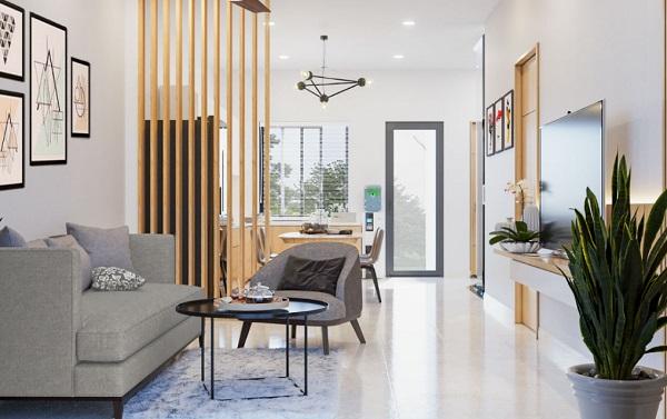 Phòng khách và nhà bếp được phân chia với hệ lam gỗ nhẹ nhàng và thiết kế theo không gian mở, giúp tối ưu diện tích