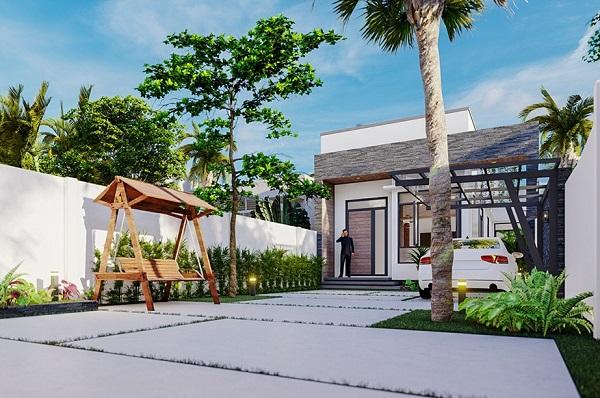 Công trình được thiết kế khéo léo với nhiều cây xanh, tiểu cảnh kèm khoảng sân rộng, thông thoáng trước nhà