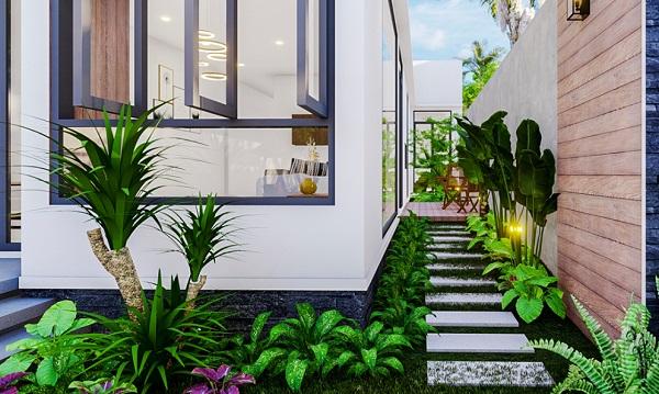 Lối đi sân vườn được thiết kế mềm mại, uyển chuyển, kết hợp khéo léo lối nhỏ bằng đá với cây xanh giúp bạn hòa mình với thiên nhiên mỗi khi bước vào nhà